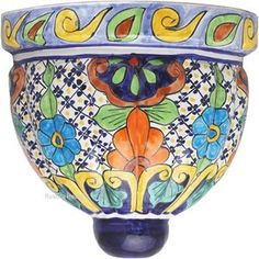#RusticaHouse #talavera #sconce will inject #Mexican #character to the #house #decor. Sconce made of #ceramic is available in small and large sizes. It has three holes. Two on the back facilitating handing on the wall and at the bottom for draining water. #Mexicantalavera sconces can be used as wall #flowerpots or #lampshade covers.