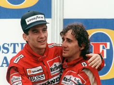 Brazilian new formula one champion Ayrton Senna (L) embraces his teammate and winner of today Adelaide Australian Grand Prix French driver Alain Prost on the podium 13 November Alain Prost, Formula 1, Hamilton, Formula One Champions, Australian Grand Prix, Mclaren F1, F1 Drivers, Thing 1, Car And Driver