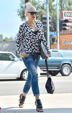 Keeping up appearances: The No Doubt star rocked a blue blouse with a pattern of white hea...