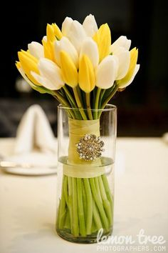 White and Yellow Tulip Bouquet / http://www.himisspuff.com/white-tulip-wedding-ideas-for-spring-weddings/4/