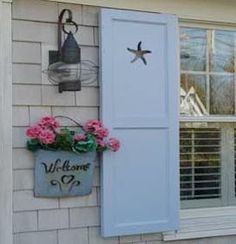 Lewes ~ This is the color of our house - even the same light fixture - now I know what color shutters I need!
