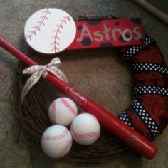 Astros wreath! Painted the sign myself, toy baseballs from a craft store & toy bat from the Astros shop. Everything's attached with craft/floral wire :)
