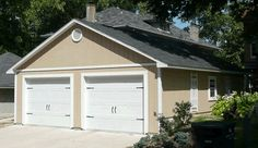 garage with carriage house overhead doors