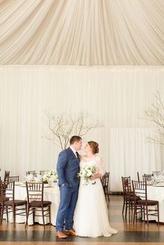 A Veritas Vineyard & Winery Wedding in Charlottesville, Virginia Indoor Reception with Tree Branch Centerpieces. | Photos by Katelyn James Photography