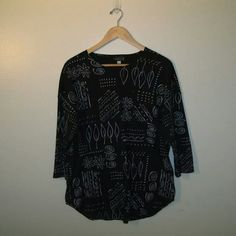 Picadilly Fashions Shirt size small Funky pattern on this oversized shirt with buttons down the front. It is size small but is very loose.  Inagine it with grey leggings, black toms and a messy bun- SUPER CUTE! Picadilly Fashions Tops Button Down Shirts