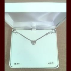 Diamond heart love necklace 17 inch Silver Diamond necklace with the word LOVE on the chain. It has never been worn and has been kept in the box it came in. Jewelry Necklaces