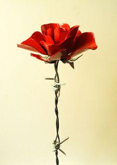 sbocciano fiori scultura