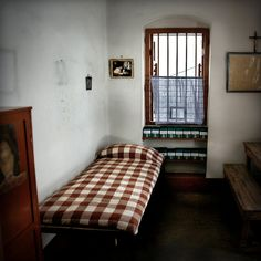 Mother Teresa's Room ©2010  Mother Teresa lived and died in this room in Kolkata India. She started, and ran the Missionaries  of Charity, which includes the Hospital for the destitute and dying. Those that are treated here, or spend their last days here, can not afford medical care and have no family to take care of them. She died in 1997. She met Pope John Paul II in 1986. The photo above her bed is of that meeting.