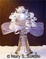 Our glass angel craft is elegant and easy. You can make it from everyday items you may already have. We'll get your imagination going! Use it as a centerpiece, candle holder, or gift.