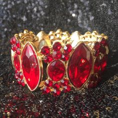 Red Crystal Cuff Bracelet NWOT red crystal bracelet set in gold tone Jewelry Bracelets