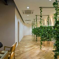 Japanese designer Kazutoyo Yamamoto of Dessence has created a beauty salon featuring hanging vines in Saitama, Japan. Called Garden By Be Area, the project aims to bring the outdoors in by separating booth-like spaces with suspended vines. A ceiling of foliage covers the hair-washing area, which features parquet flooring and wooden cabinets. The glass-fronted waiting More