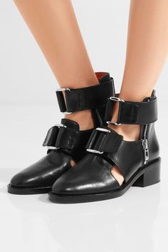 Heel measures approximately 45mm/ 2 inches  Black leather Buckle-fastening straps