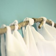 DIY branch curtain rods- If you're like me, your house is super eclectic, the majority of your decor is second hand. So, why not add another unique touch by making curtain rods our of a tree branch? It's super cute and totally FREE! Branch Curtain Rods, Diy Curtain Rods, Wood Curtain, Curtain Ideas, Rustic Curtain Rods, Curtain Holder, How To Make Curtains, Diy Curtains, Cabin Curtains