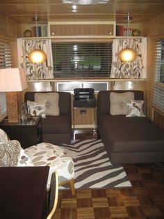 Great color scheme in this spartan!  Love the seating / bed Idea!  Great idea beds for boys!