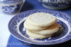 Old Fashioned Southern Tea Cakes - Old fashioned, authentic southern tea cakes are basic, simple sugar cookies in their list of ingredients - butter, sugar, flour and eggs - but they speak so much more to our history, heritage and memories.