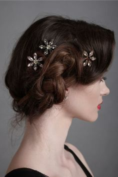 Hair would be in a vintage inspired up do with flower pins.