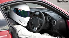 Some say, that if your remove his helmet, his head will violently decompress, and that he was once raised by wolves, all we know is he's called The Stig!
