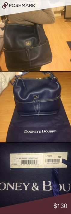 """Large Dooney & Bourke handbag Authentic. Gorgeous dark blue color. Used only twice with minimal wear on bottom of handbag (shown in photos). Purchased from Macy's for $278 as shown in photos. H 9.5"""" x W 5.75"""" x L 12"""" Two outside zip pockets. One inside zip pocket. Two inside pockets. Cell phone pocket. Inside key hook. Zipper closure. Strap drop length 10"""". Dust bag included Dooney & Bourke Bags Shoulder Bags"""