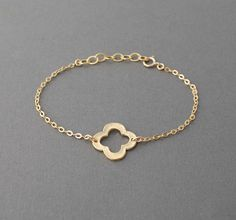 Gold Clover Quatrefoil Bracelet also in Silver. $23.00, via Etsy.
