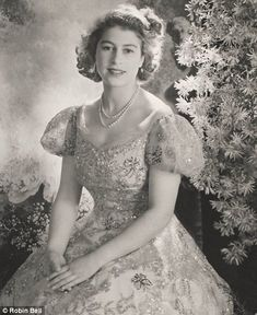 I am currently obsessed with everything British.  The Queen at Buckingham Palace in 1945