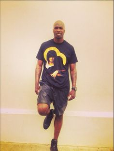 Chad @Christina Phillips Wears A Givenchy Gangster Madonna Tee-Shirt, Balmain Shorts & Saint Laurent Paris Sneakers