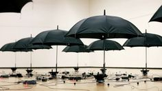 kouichi okamoto's rain installation expresses gravity, magnetic forces, and sound