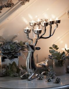 Decking the hall with frosted faux flowers and foliage that will look after itself is an easy way to make your home feel festive. But if you really want to wow family and friends, create a glowing focal point with this striking reindeer tealight holder from @Sainsburys new Ice Palace collection. #sainsburyshome #sponsored http://trib.al/SUkvJKB