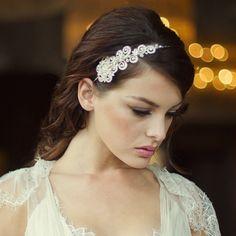 The Cecilia Bridal Headband is a romantic and stylishheadband with a luxurious combination of crystals and ivory simulated pearls on a silver plated finish.Design size-width 13cm x height 5cm.This piece is beautifully presented in Roman