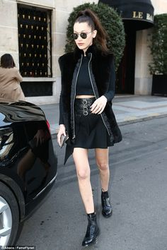 Defying the weather: Braving the cold temperatures, the Bella went bare legged in a mini s...