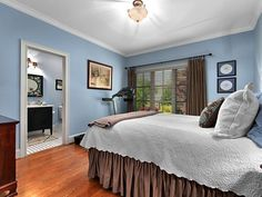 cool blue bedroom with brown accents amp adjacent bathroom reclaimed wood ceiling transitional this master