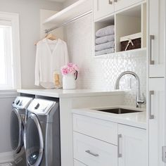 Laundry room with folding spot and hanging spot -- storage/sink/ light- bright Placed by the master with laundry shute coming from boys bathroom upstairs--