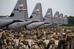 Soldiers from the 82nd Airborne Division ready their gear prior to jumping from Air Force C-130J Hercules during a Joint Operation Access exercise June 24. A total of 2,426 paratroopers jumped out of C-130Js during the 12-day exercise, which is designed to prepare Airmen and Soldiers to respond to worldwide crises and contingencies. (U.S. Air Force photo by Airman 1st Class Damon Kasberg)