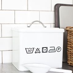 Cox & Cox Washing Powder .  Utility needn't be utilitarian. An ample sized metal washing powder tin, with a lid and scoop. Matches our White Utility Storage Bucket. Durable enameled finish. £32