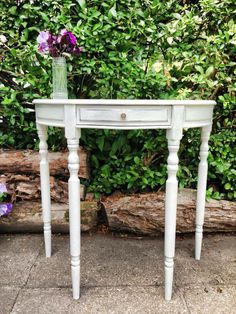 A demi lune side table painted in Sloan Paris Grey. 1 available. By bAd ALiCe.