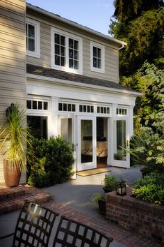 Pretty, traditional porch with brick accents and multiple levels. Like the Frenc… Pretty, traditional porch with brick accents and multiple levels. Like the French doors and transoms. House Design, French Doors, Home Additions, Remodel, Windows Exterior, House Exterior, Window Styles, Brick Patios, Traditional Porch