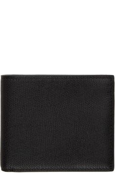d8fa7579298 Grained calfskin bifold wallet in black. Lacquered edges. Gold-tone logo  stamp