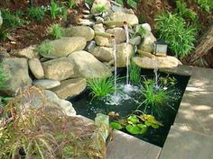 I like the BIG rocks (as long as they won't move) with the bamboo tubs to make the waterfall. I could do the bamboo tubs with many different pond designs.