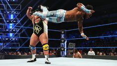 One-half of each tandem in the SmackDown Tag Team Title Match at WWE Extreme Rules clash in a contentious Triple Threat Match. Xavier Woods, Daniel Bryan, Wwe News, Wwe Photos, Wwe Superstars, Tandem, New Day, Running, Sports