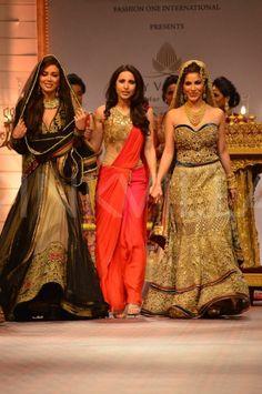 Dhoti saree, Mandira Wirk, the designer (center)