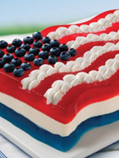 All-American Flag Mold -- Chilled in a flag-shaped mold, a COOL WHIP and lemon gelatin mixture separates layers of red and blue gelatin for a special patriotic dessert.