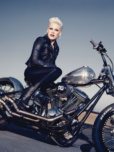 "Alecia Beth Moore (also known as the artist ""Pink"") sitting atop a Harley Chop… lookin' gorgeous as always.  Maybe I'm just flattering myself, but I feel like she might be my doppelgänger."