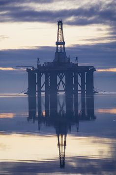 Oil rig anchored in the Cromarty Firth at sunset, Cromarty Firth, Ross-shire, Scotland, UK.