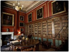 The Inner Library - Attingham Park. Rosewood centre-table c.1810. Mahogany armchairs with lions' head terminals to the carved arms c.1808.