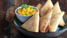 Smoked chicken samosa with mango chutney    A modern samosa flavor of smoked chicken, onion and cheese. Tangy and spicy mango chutney on t...