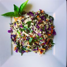 "Superfoood ""Fried Rice"" Cauliflower 1 head cauliflower, ""riced"" or finely chopped 2 tablespoons avocado oil 1 shallot, julienne  2 cloves fresh garlic, chopped 1 cup shredded red cabbage 1 cup shredded carrots 2 cups finely chopped kale, stems removed 2 teaspoons toasted sesame oil ½ teaspoon sea salt Fresh cracked black pepper to taste ½…"
