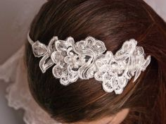 Lace headband -  Bridal lace headpiece - Bridal headband - Ivory headband. $38.00, via Etsy.