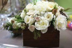 Winter centerpiece: peonies, garden roses, lotus pods, spray roses, pinecones, princess pine, gardenia, succulents