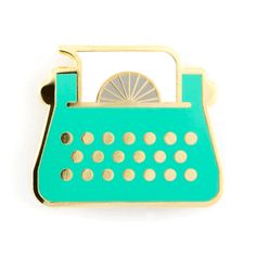 """Just my type... writer - Gold pin with colored enamel - Rubber backing - Measures 1"""" wide"""