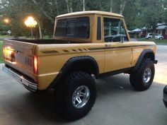 Love Ford Bronco Half Cabs.  The stripes on this one are sick!!!!