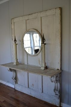 Amazing shelf made from an old large door and corbels.